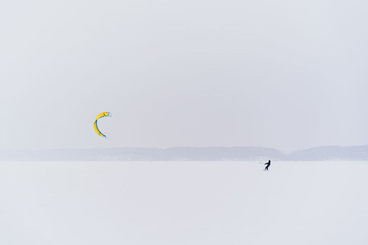 Sport Adventure Extreme Sports Leisure Activity Outdoors Winter Sport Winter Kiteboarding Snowboarding Exploration Kitesurfing Kitesurfer Snow Frozen Lithuania Kaunas Snowstorm Alone Brave Extreme Weather Freedom Lifestyles One Person Unrecognizable Person Scenics - Nature