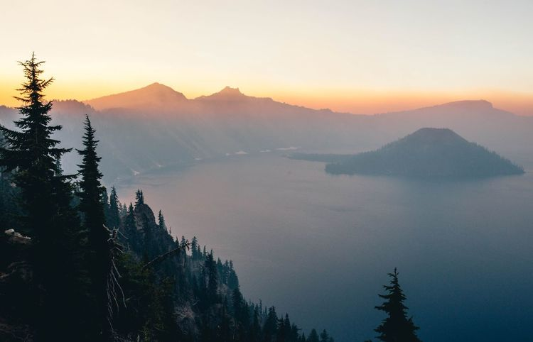 Crater Lake National Park north of Medford. The haze you see in the photo is from forest fires during the summer of 2017 Landscape_captures Landscape_lovers Landscape_photography Landscape Landscape_Collection Photography Hiking Smoke Sunsetporn Sunset Silhouettes Sunset Sunset_collection National Park Roadtrip Oregon Crater Lake National Park Eye4photography  EyeEm Nature Lover EyeEm Best Shots Lake Mountain Nature Beauty In Nature Tranquil Scene Tranquility Scenics Fog Outdoors No People Tree