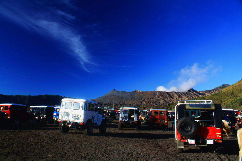 Traveling to Mount Bromo 4wheeldrive Mount Bromo Blue Cloud - Sky Day Jeep Land Vehicle Landscape Men Mode Of Transport Motor Home Mountain Mountain Range Nature Outdoors People Semi-truck Sky Transportation Volcano