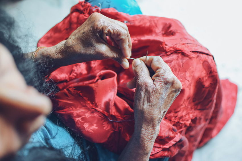 InMakin! Working Hands Old Hands Thread Needle Stitch Fabric Cloth One Woman Only High Angle View Randomness People Selective Focus Colourful Bright Colors Human Hand Red Close-up Inner Power This Is Family