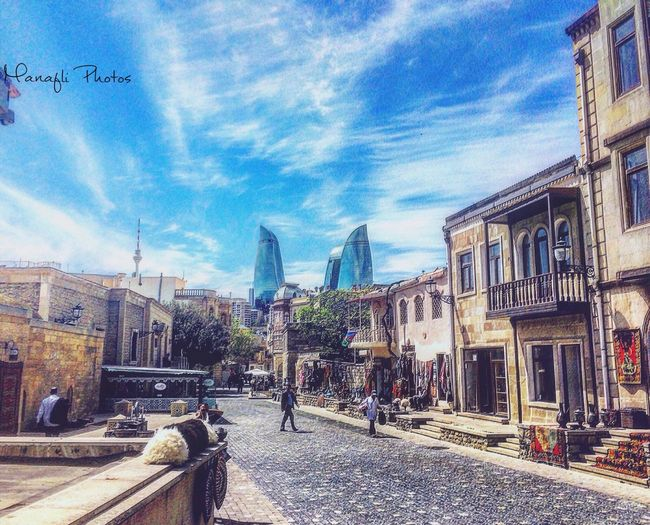 EyeEm Best Shots Eyemphotography Architecture Building Exterior Built Structure Transportation City Sky Street Day Mode Of Transport Railroad Track Road Outdoors Cloud - Sky Real People Men People Baku Azerbaijan Flametowers Old EyeEm EyeEm Gallery EyeEm Selects