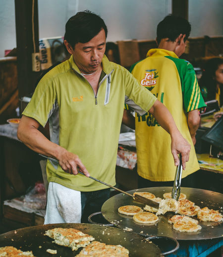 cooking meal Cooking Dinner Lunch Market Meal Chef Commercial Kitchen Cooking Time Day Food Food And Drink Food Festival Food Market Freshness Indoors  Kuliner Kulinerindonesia Masak Men People Preparation  Real People Standing Uniform