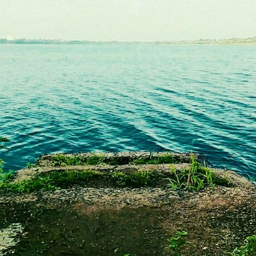 The Backwaters... Nagpur Lake Lake View Lakeside Water Nature Outdoors Tranquility Beauty In Nature No People Day Sky Grass Horizon Over Water Rippled Scenics