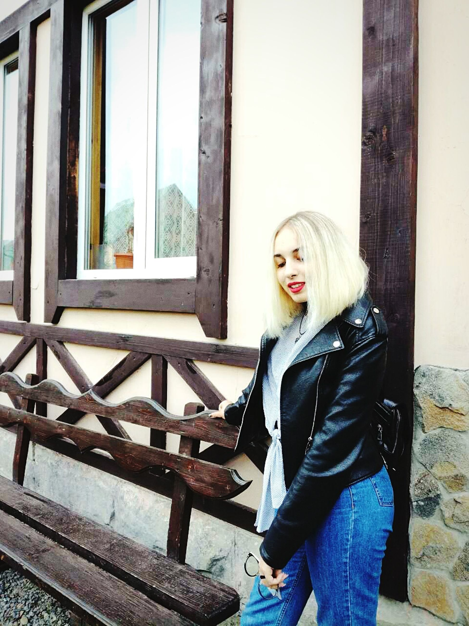 one person, young adult, young women, real people, beautiful woman, window, casual clothing, jacket, leisure activity, lifestyles, day, sitting, waiting, blond hair, architecture, indoors, portrait, people