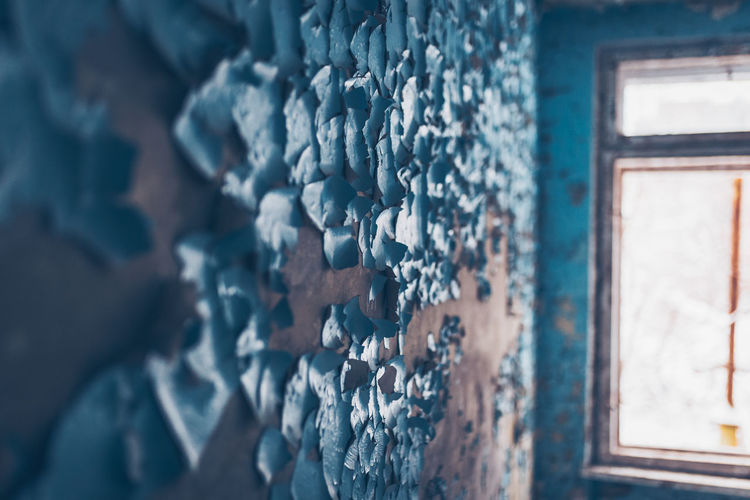 Peeled wall in abandoned house