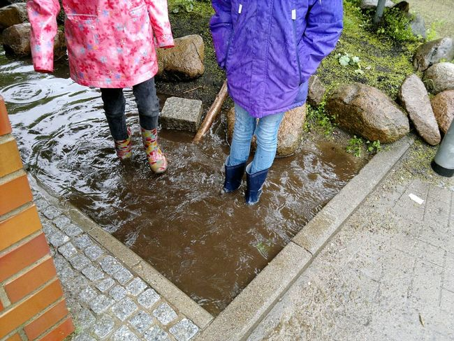 Rainy Days Puddle Rubber Boots Rubber Boot Wellies  Rainwear Kids In A Puddle Playing In A Puddle Children In A Puddle