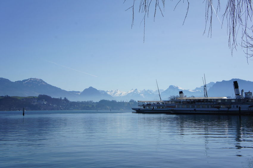 Steamboats on Lake Lucerne Alps Switzerland Beauty In Nature Blue Blue Water Day From My Point Of View Harbor Lake Lucerne Mode Of Transport Mountain Mountain Range Nature Nautical Vessel No People Outdoors Scenics Sea Sky Steamboat The Purist (no Edit, No Filter) Tranquil Scene Tranquility Transportation Water The Great Outdoors - 2017 EyeEm Awards