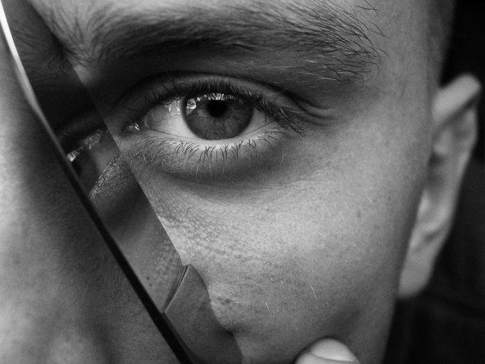 Close-up portrait of man with knife