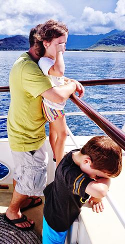 A long day's journey Ocean Boating Boat Sea Nautical Vessel Togetherness Water Happiness Love An Eye For Travel Men Beach Adult Yacht Summer Leisure Activity Sailing Cheerful Father Vacations