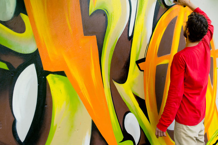 Casual Clothing Colorful Colors And Patterns Creative Creativity Graffiti Graffiti Art Hands At Work Modern Modern Art Multi Colored Mural Mural Art Orenge Colors Painter Red Street Photography Streetart Urban Lifestyle Youth Of Today