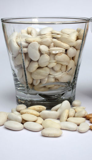 White beans close up Agriculture Appetizing  Background Bean Cooking Cuisine Dry Food Gourmet Grain Healthy Ingredient Legume Natural Nutrition Organic Pile Protein Raw Seed Vegetable Vegetarian Vitamin Whole