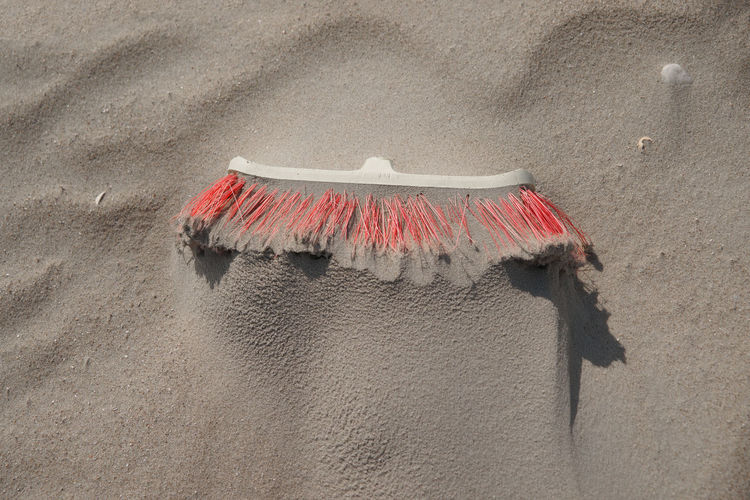 High angle view of clothes hanging on beach