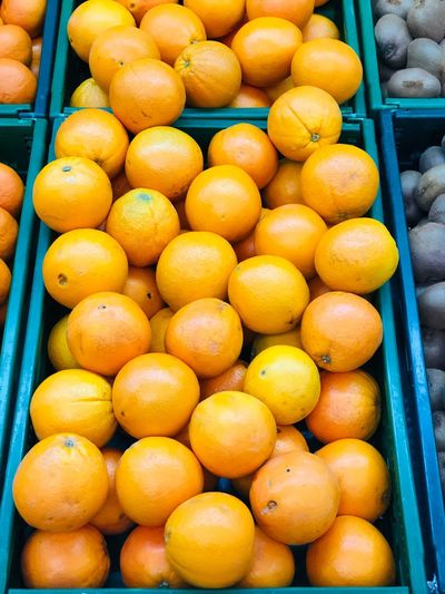 High angle view of oranges in crate at market stall