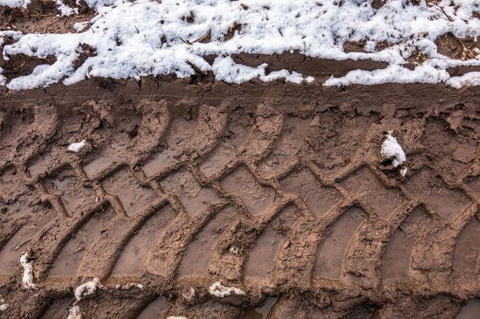 Tire track in the muddy ground Agrarian Agriculture Farmer Farmland Tractor Winter Agricultural Agricultural Land Agricultural Productivity Farming Fertile Snow Tire Marks Tire Track Tire Tracks Tractors