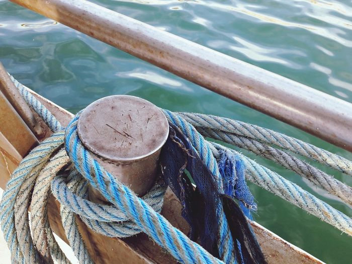 High angle view of rope tied on boat
