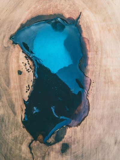 High angle view of water fallen on wooden table