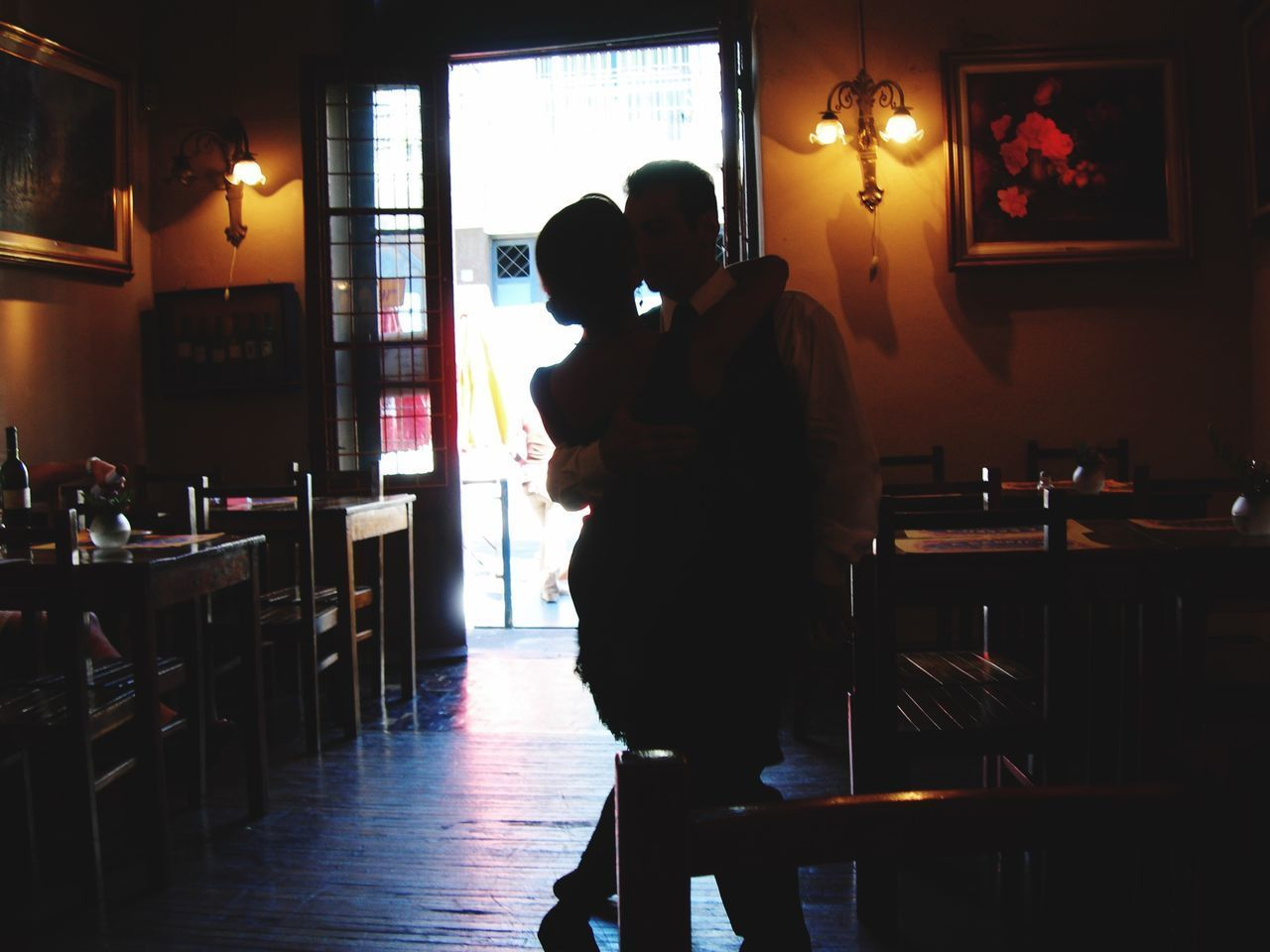 two people, real people, women, men, love, indoors, adult, positive emotion, lifestyles, togetherness, standing, illuminated, people, emotion, leisure activity, females, bonding, food and drink, rear view, family, couple - relationship