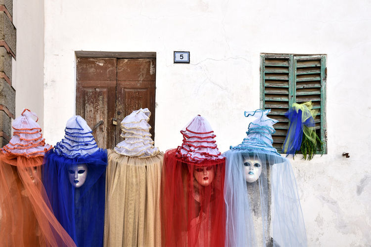 colorful carnival masks Architecture Architecture Blue Building Exterior Built Structure Carnevale Carnevale Di Venezia Color Portrait Colorful Colors Door Drying Five Hanging Laundry Maschere Maschere Carnevales Maschere Veneziane No People Number Orange Color Outdoors Red Color Tulle Window