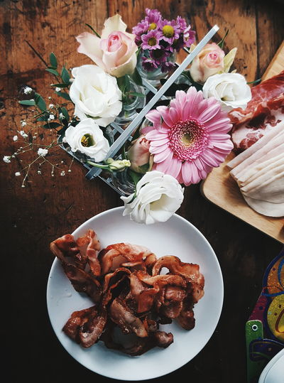High angle view of bacon and flowers