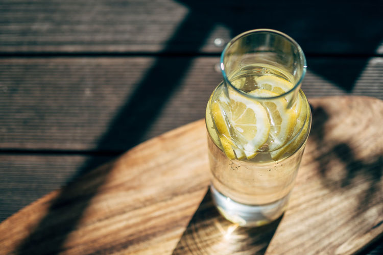 It's hot outside! Food And Drink Lemonade Citrus Fruit Drink Drinking Glass Food Food And Drink Freshness Fruit Glass Herb High Angle View Household Equipment Lemon Lemon Soda Lime Mint Leaf - Culinary No People Outdoors Refreshment Shadow SLICE Still Life Sunlight Table Wood - Material