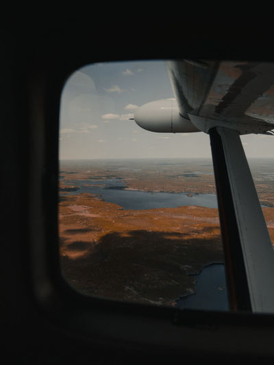 View of landscape through airplane window