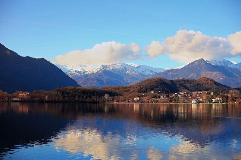 Avigliana, italian village landscape with alps mountains and lake, piemonte region