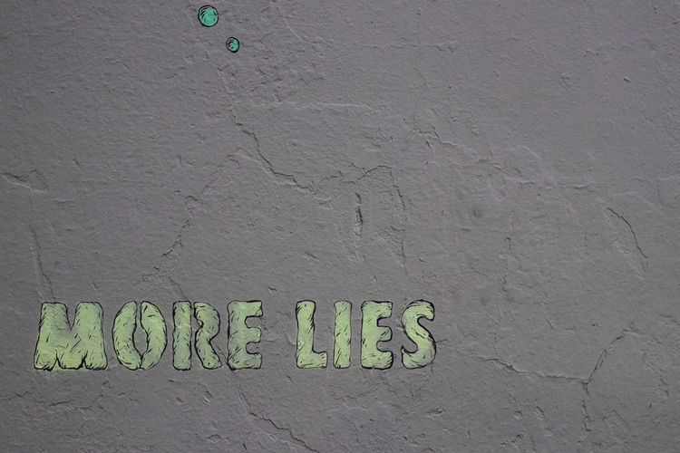 Textured  Close-up Day Green Green Color Lie Lies More More Lie No People Outdoors Text Wall - Building Feature