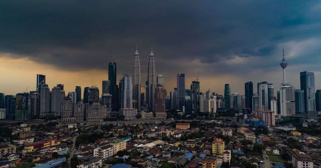 Kuala Lumpur before raining Kuala Lumpur City Centre KL TOWER KLCC Twin Towers Kuala Lumpur Skyscraper Architecture Tall - High Cloud - Sky Building Exterior Tower Sky Built Structure Cityscape City Modern Travel Destinations Urban Skyline Downtown District Sunset