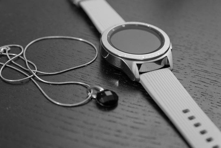 EyeEm Best Shots Eye4photography  EyeEm Best Pics EyeEm Bnw Blackandwhite Black And White Black & White Blackandwhite Photography Monochrome Close-up Still Life Indoors  Table Selective Focus Technology Two Objects Equipment Personal Accessory Metal Connection Necklace Watch Samsung Watch Smart Watch