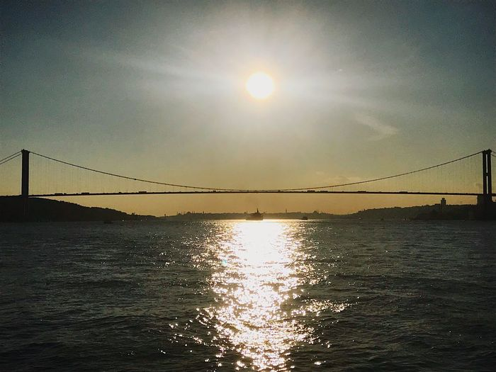 Sun Connection Water Sky Bridge - Man Made Structure Sea Sunlight Suspension Bridge Day No People Sunset Beauty In Nature Architecture Nature