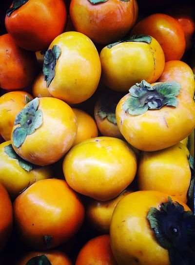 Full frame shot of persimmons in market