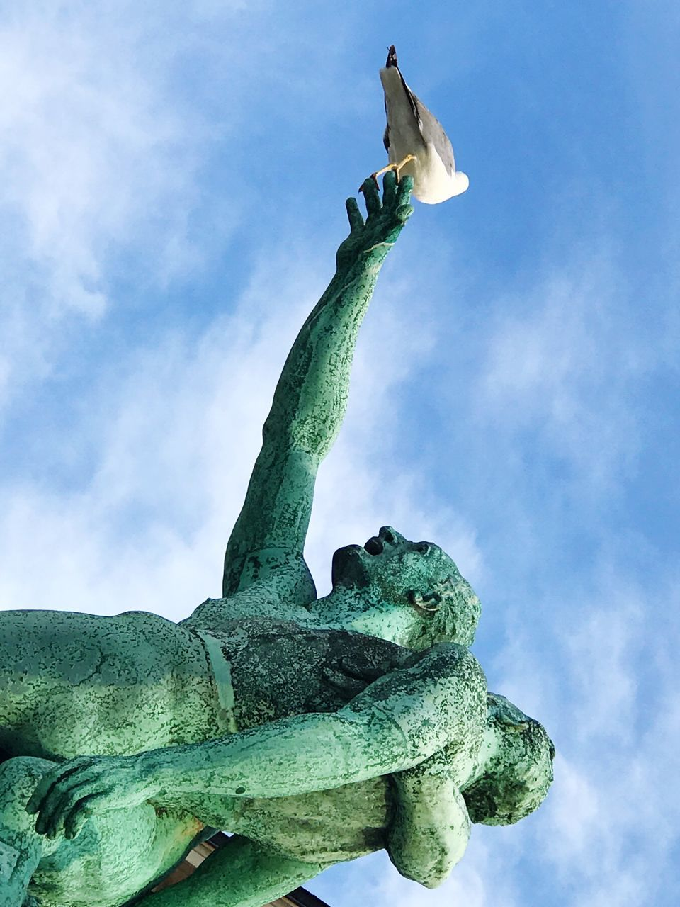 statue, sky, low angle view, sculpture, cloud - sky, day, outdoors, no people, green color, nature, beauty in nature