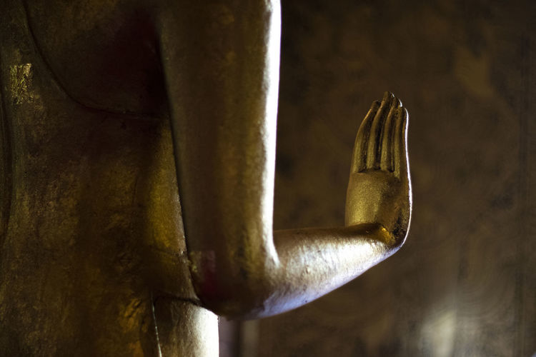 Close-up of a buddha statue against wall