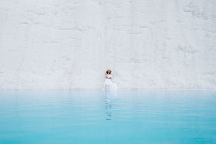 Young woman by travertine pool at pamukkale