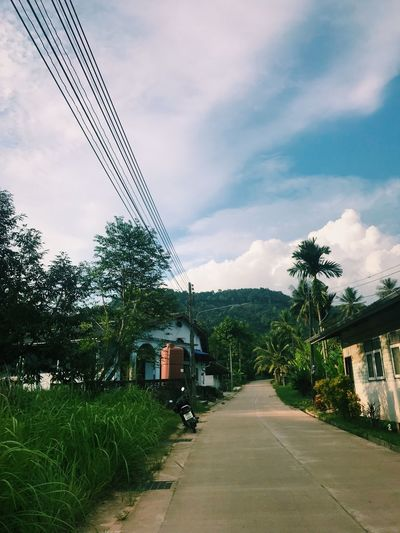 Island village Backpackingthailand Thailand Local Kohyaonoi Sky Built Structure The Way Forward Transportation Cloud - Sky Architecture Cable Outdoors Day Road Street Electricity Pylon Tree No People Telephone Line Building Exterior Nature Mountain