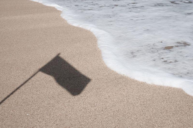 High angle view of shadow on beach