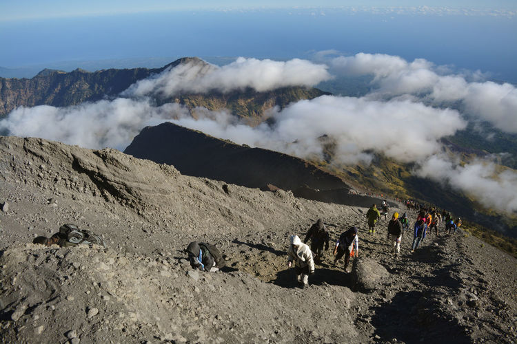 Group of people on volcanic mountain