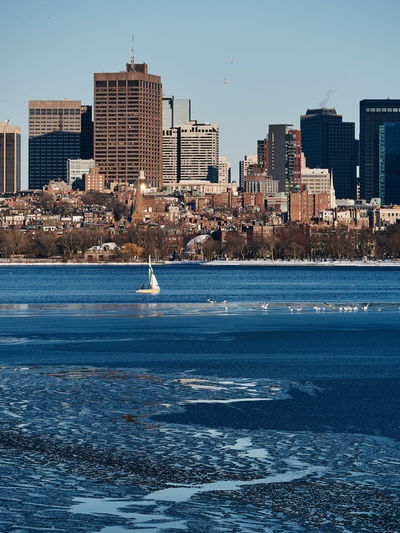 Built Structure Architecture Building Exterior City Water Building Sky Urban Skyline Nature Office Building Exterior Clear Sky Cityscape Skyscraper Outdoors Day No People Landscape Modern Beacon Hill Charles River Boston Sailboat Frozen Winter Ice