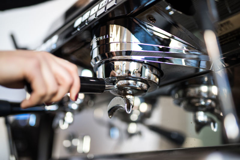 Close-Up Of Person Preparing Coffee In Cafe