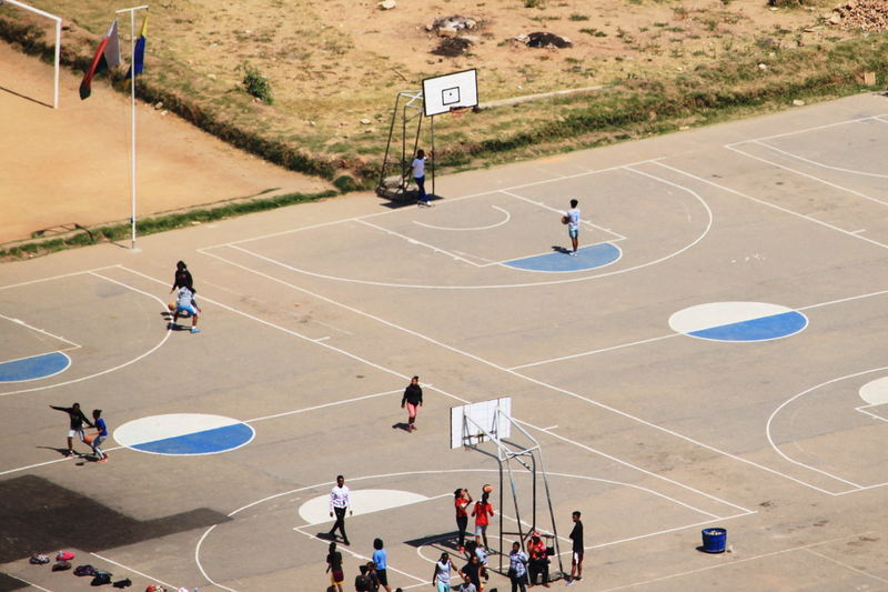 High angle view of people playing at basketball court