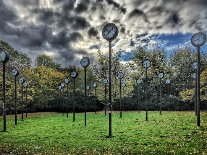 Zeitfeld im Volksgarten Tree Grass No People Outdoors Day Street Light Cloud - Sky Sky Tranquility Beauty In Nature Growth Nature Clock