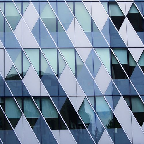 Full frame shot of glass building with windows