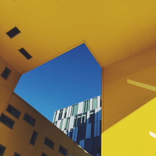 Yellow. Building Exterior Architecture Low Angle View Blue Built Structure Yellow No People Day Outdoors Sky The City Light Minimalist Architecture