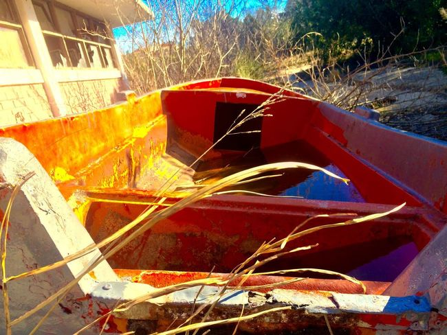 Boat on the field. EyeEmNewHere EyeEm Best Shots Grass Water Boat No People Day Outdoors Built Structure Building Exterior Sunlight Architecture Nature Close-up