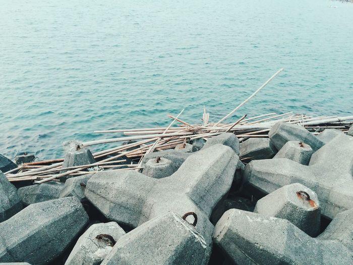 Tetrapod rocks against sea