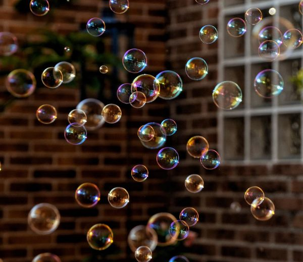 Close-up of bubbles against brick wall