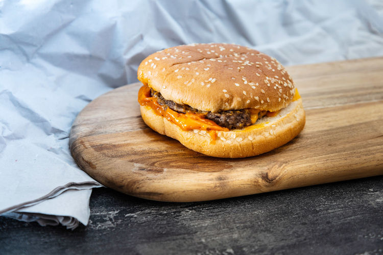 Close-up of burger on serving board