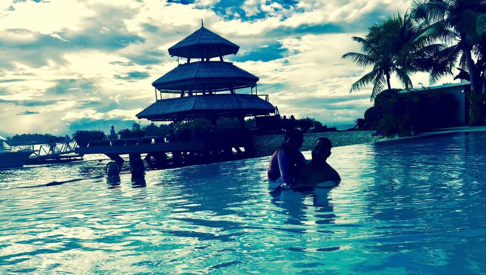 Sky Cloud - Sky Architecture Real People Water Building Exterior Day Outdoors Vacations Travel Destinations Palm Tree Nature Swimming Pool Beauty In Nature People Island Davao Philippines Family Edited Blue Color