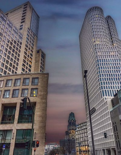Low angle view of modern buildings against sky at dusk