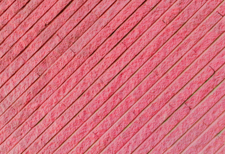 surface of the brick wall for design and background Backgrounds Full Frame Red Pattern Textured  Close-up No People Striped Abstract Textile Pink Color Day Copy Space Textured Effect Outdoors Wood - Material Design Element Extreme Close-up In A Row Directly Above Wood Grain Ornate